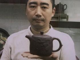 宜兴紫砂名家周孝忠照片