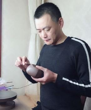 紫砂壶工艺师毛健名家照片