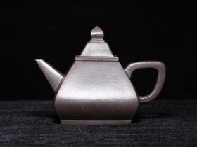 如何清除紫砂壶内壁茶垢?