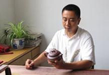 紫砂壶工艺师郑剑锋名家照片